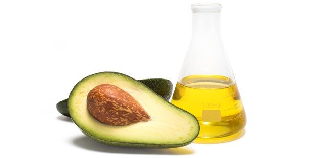 Avocado and oil on white background