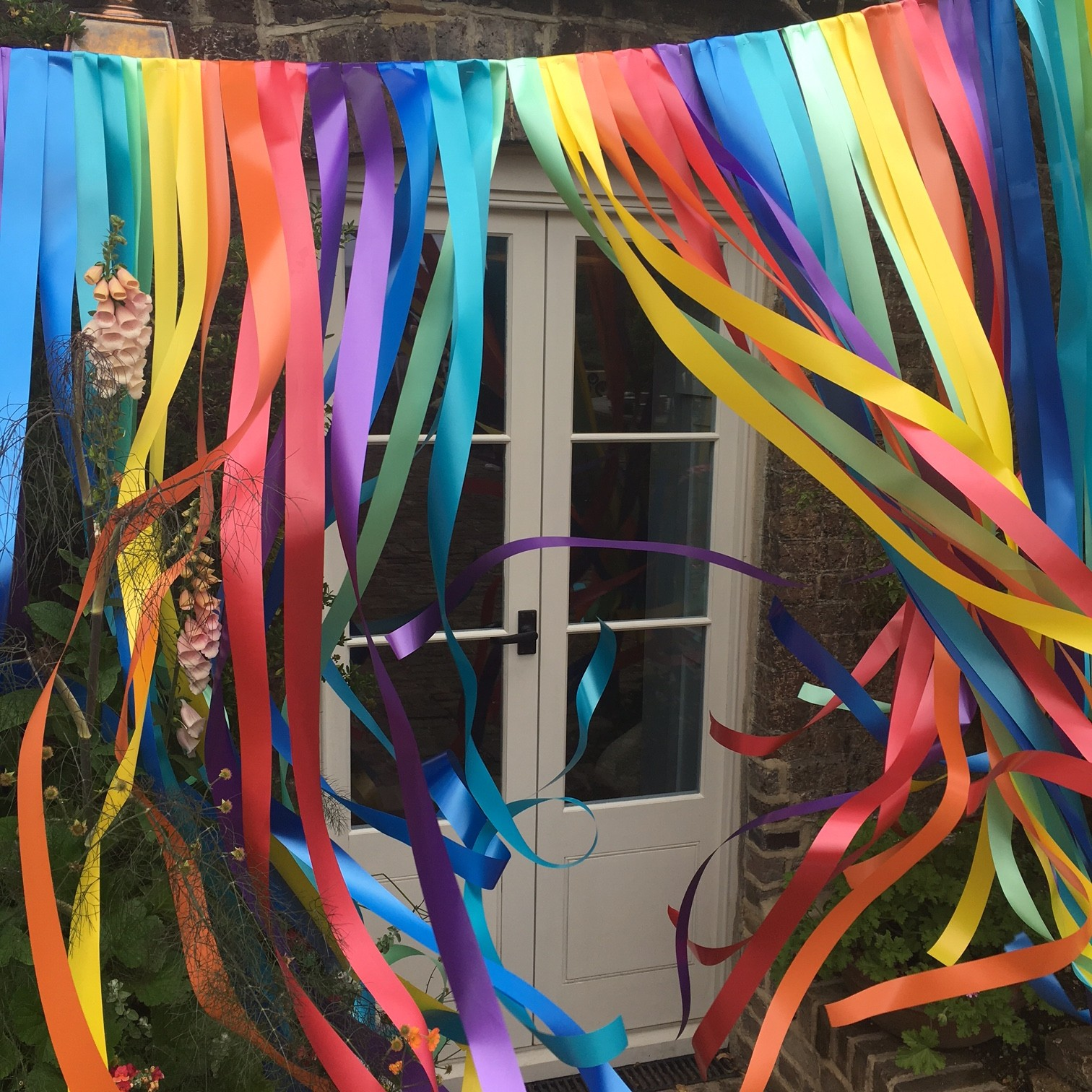 This rainbow ribbon garland provided the perfect Instagram backdrop for guests