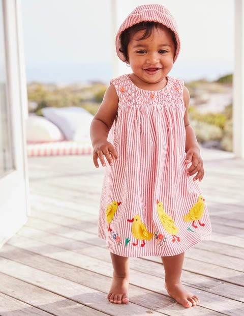 Pink Seersucker Bonnet, £16, Boden , Appliqué Smock Dress with matching knickers, from £28, Boden