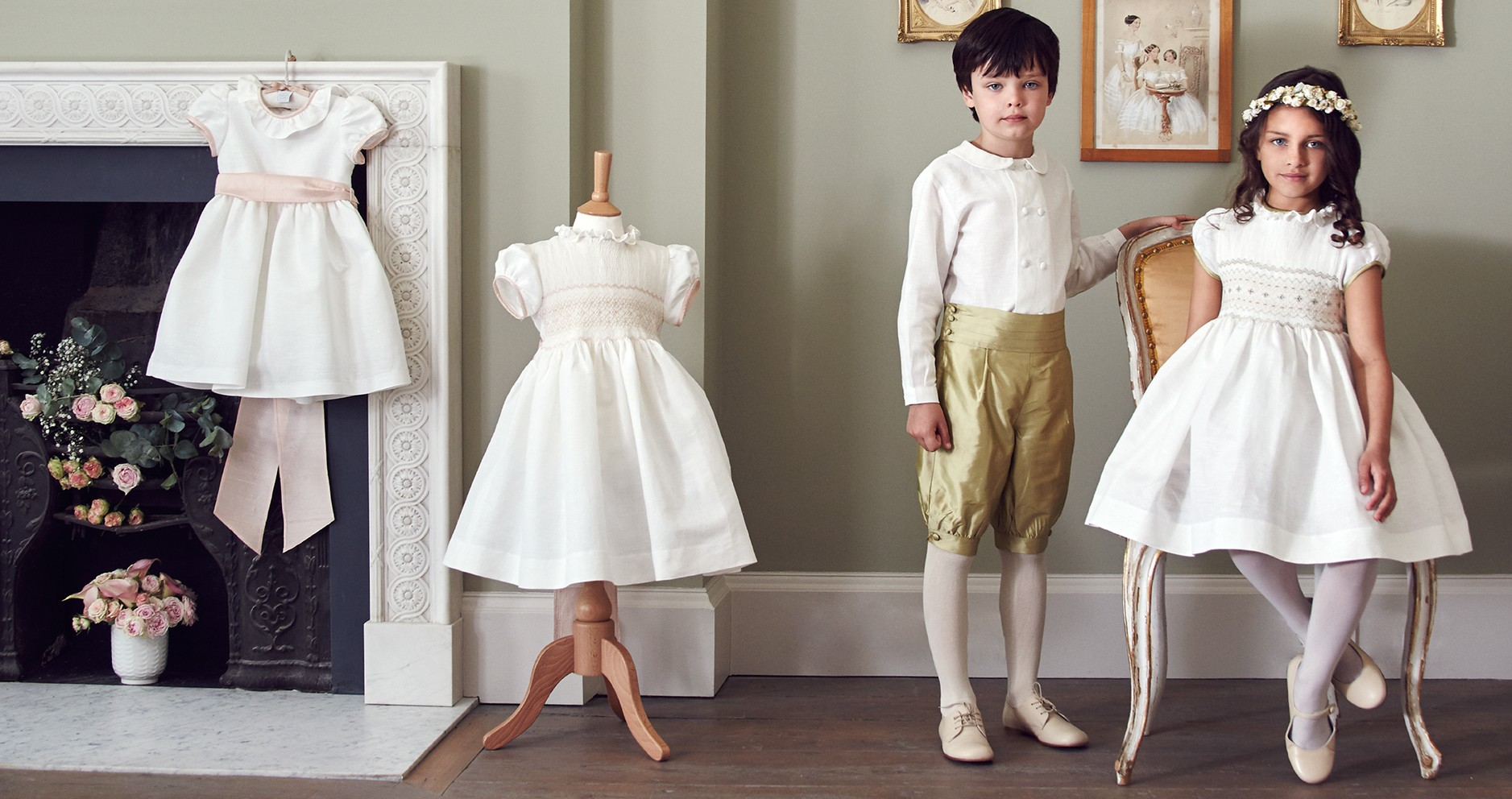 Items from the Celebration collection. Pageboy's silk knickerbockers, £94; boy's double-breasted shirt, £89; girl's occasion smocked dress, £340.
