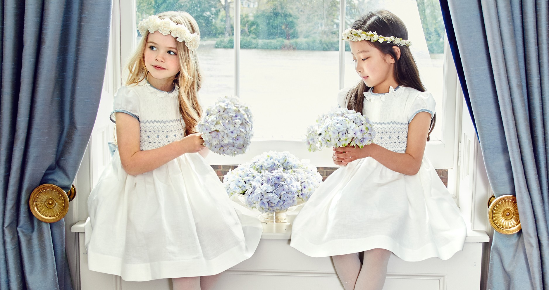 Pepa & Co's white smocked dresses are available from the Celebration Collection with blue, green or pink detailing. Flower crown on left, £52; flower headband on right, £98.