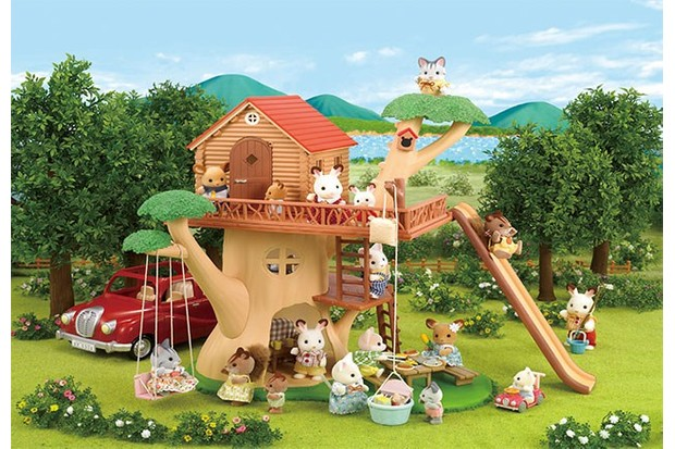 Sylvanian Families has created a dream treehouse, complete with a swing and a fun slide.