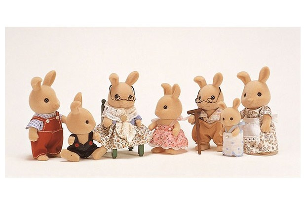 This vintage ivory rabbit family was created in 1986.