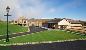 The barn sits surrounded by glorious green space, perfect for children to run around.