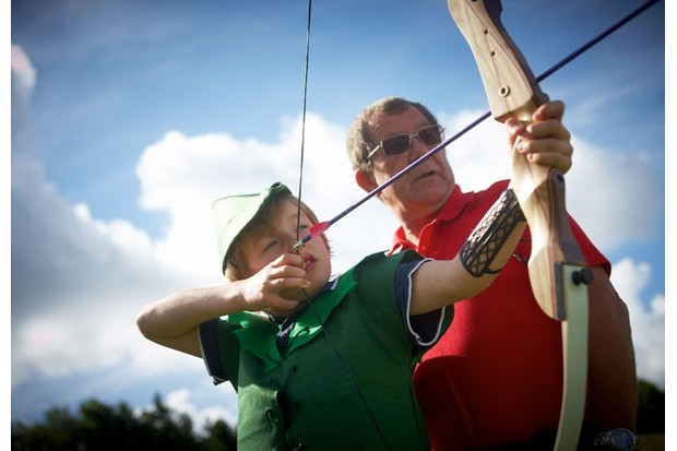 The experienced on-site archery tutor with a student
