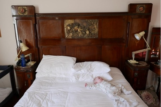 Baby Ralph makes himself comfortable in the spectacular double bed at Woolley Grange. (Photo: Alex Lloyd)