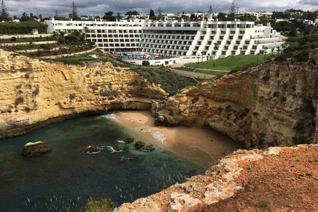 Set back into the sandy-brown rocks, the hotel leads on to picturesque cliff walks