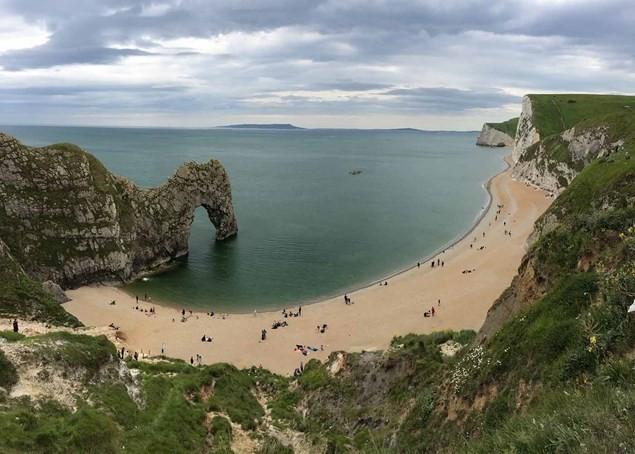 Durdle Door rock arch and beach in Dorset