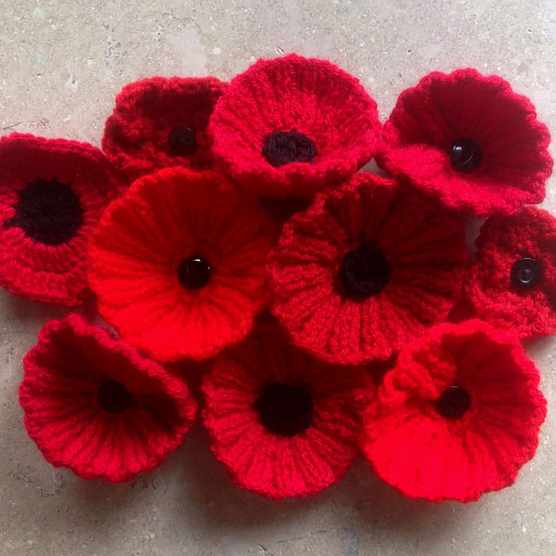 Poppy knitting pattern, pile of knitted poppies