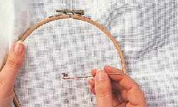 How to use an embroidery hoop for cross stitch step 3