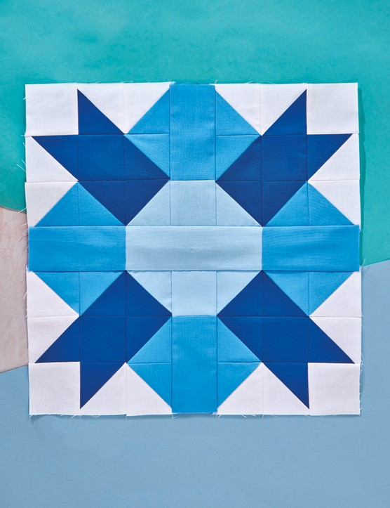 Paws and pluses quilt block pattern blue