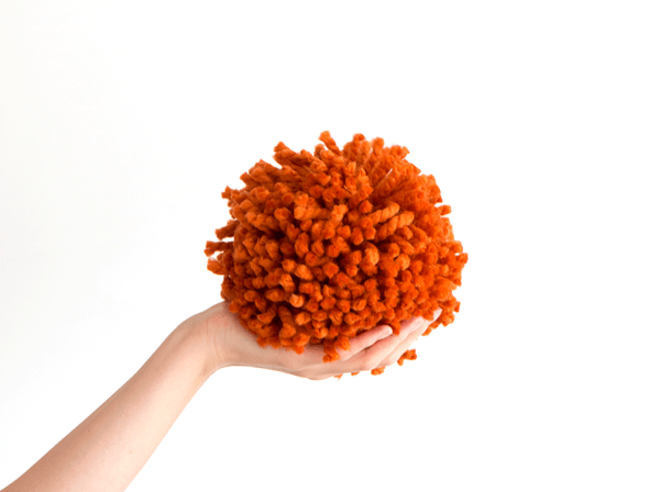 Giant orange pom pom