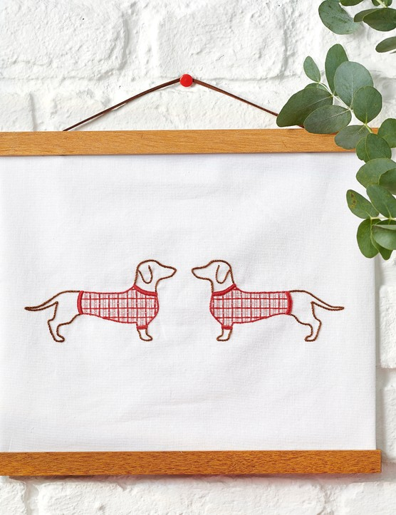 Tartan sausage dog banner from Love Embroidery issue 19