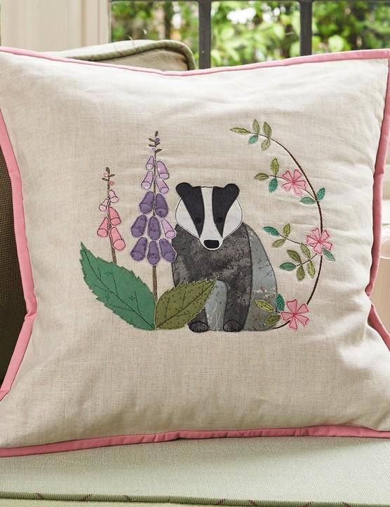 Applique badger cushion