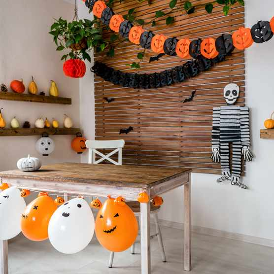 Halloween theme decorated living room. Lifestyle Halloween season family house interior. Traditional Halloween decorations background.