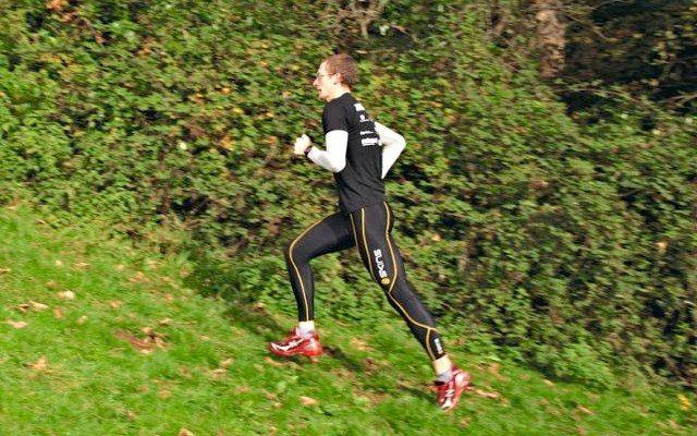 Triathlete running up a hill