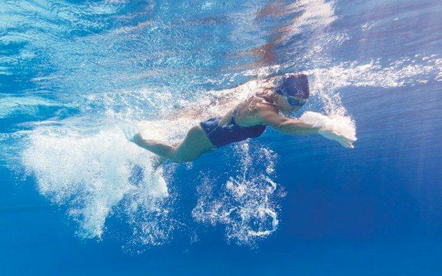Female triathlete in swim training