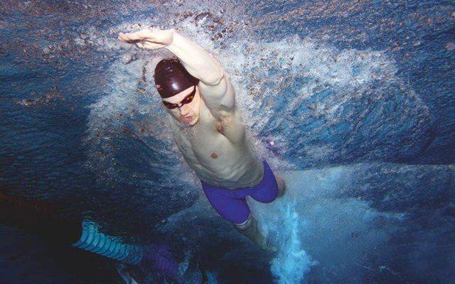 Triathlete swimming front crawl