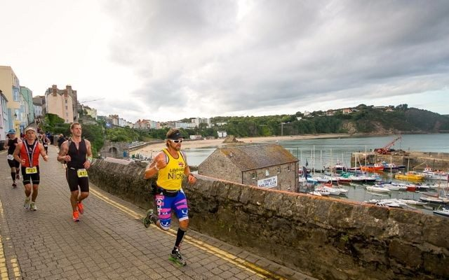 Male triathlete running at Ironman Wales