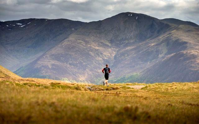 Triathlete running off-road