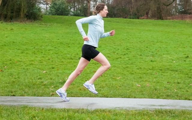 Female triathlete in run training