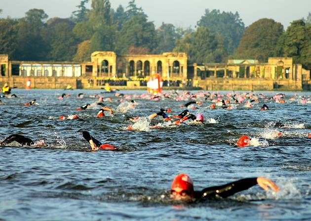 Athletes swimming at Hever Castle Triathlon