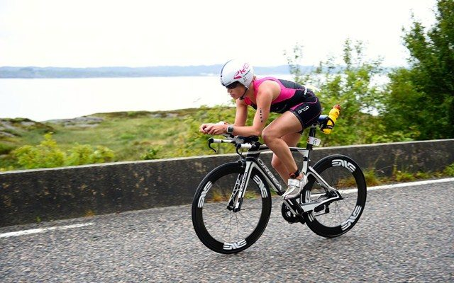 Female triathlete on the bike