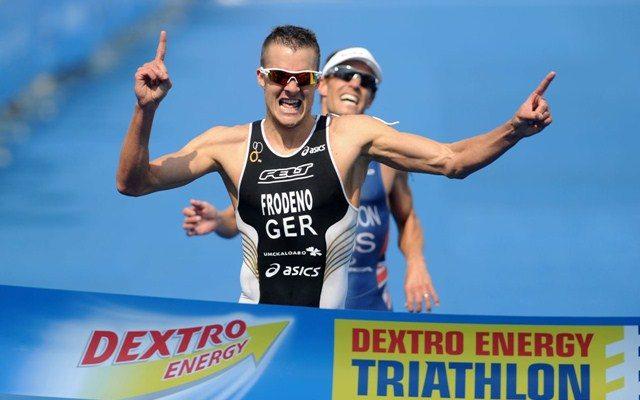 Jan Frodeno breaks the finishing tape in a race