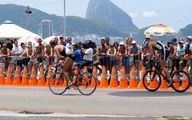 Triathletes racing along Copacabana beach