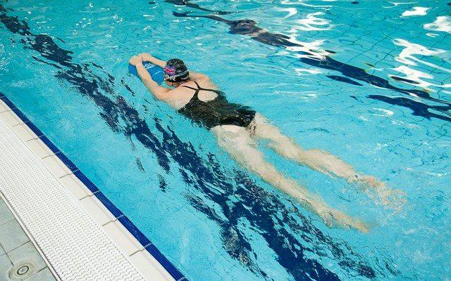 Triathlete using a kick float in swim training