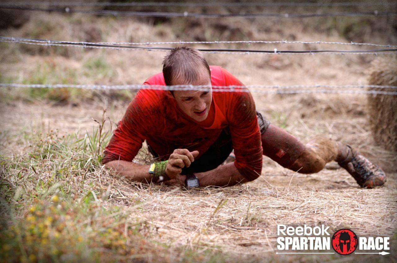 Jonathan Albon crawls through barbed wire