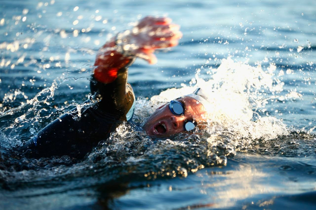 Triathlete swimming in a lake