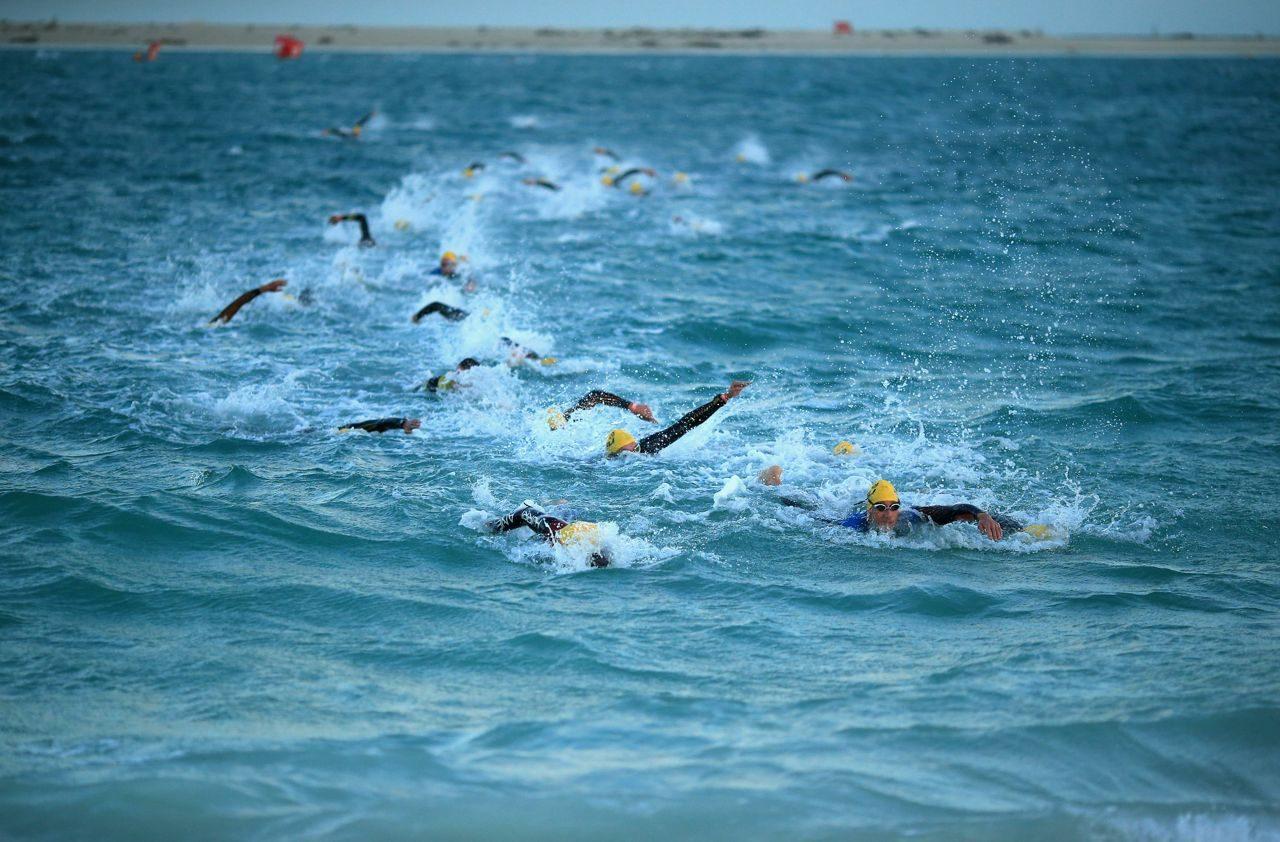 Triathletes swimming in the sea