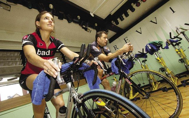 Athletes on the turbo trainer side by side