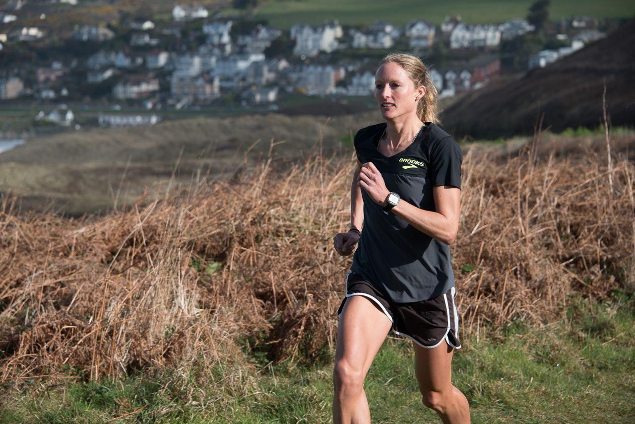 Female triathlete in run training