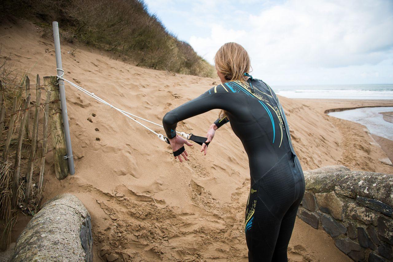 Female triathlete using stretch cords