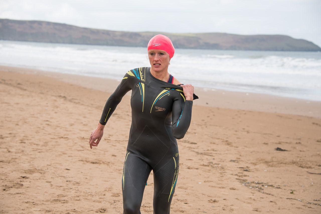 Female triathlete finishing a swim session