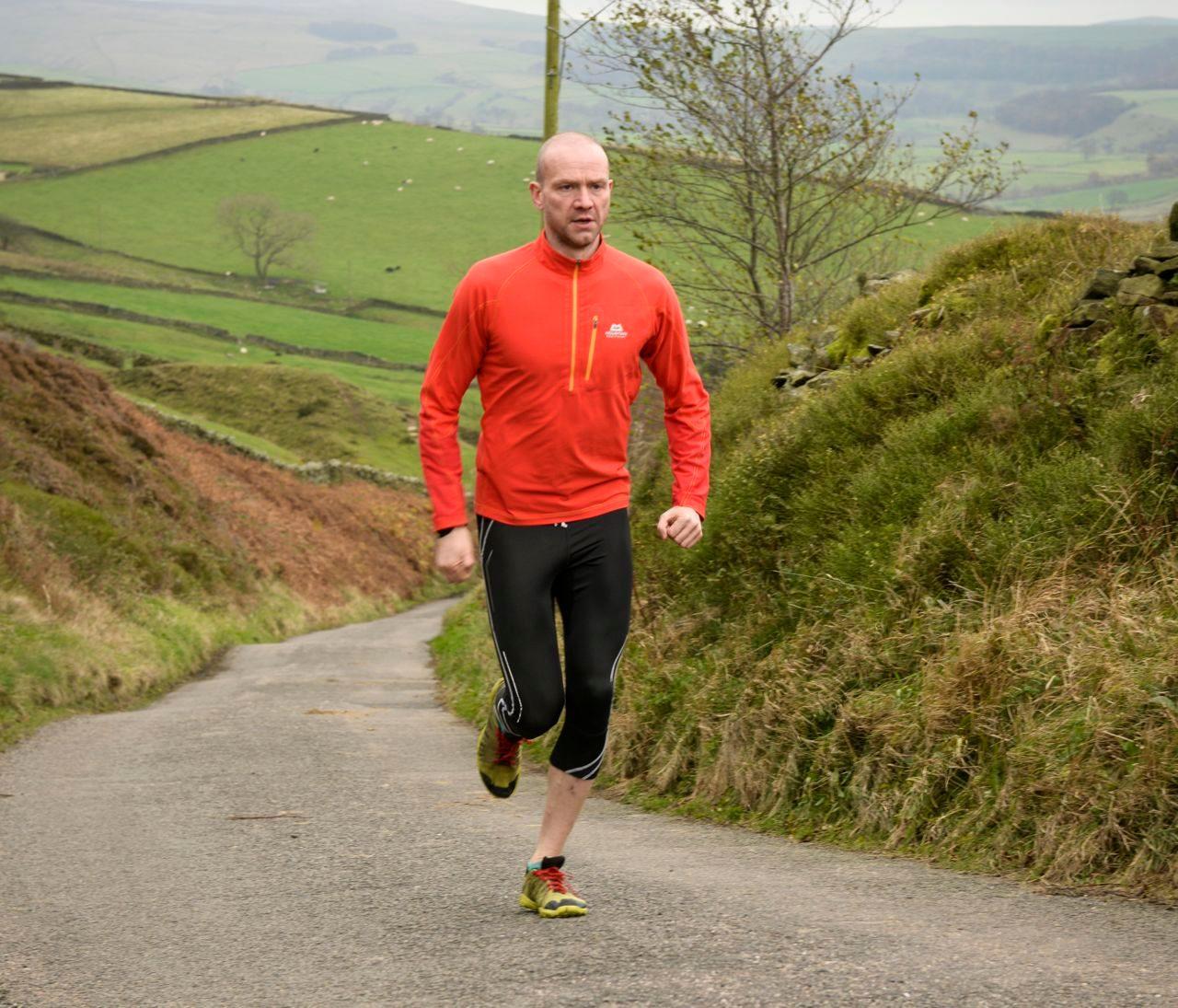 Nik Cook running up a hill