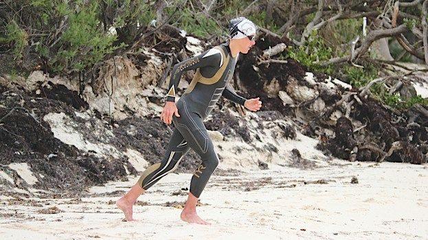 Chrissie Wellington running into the sea