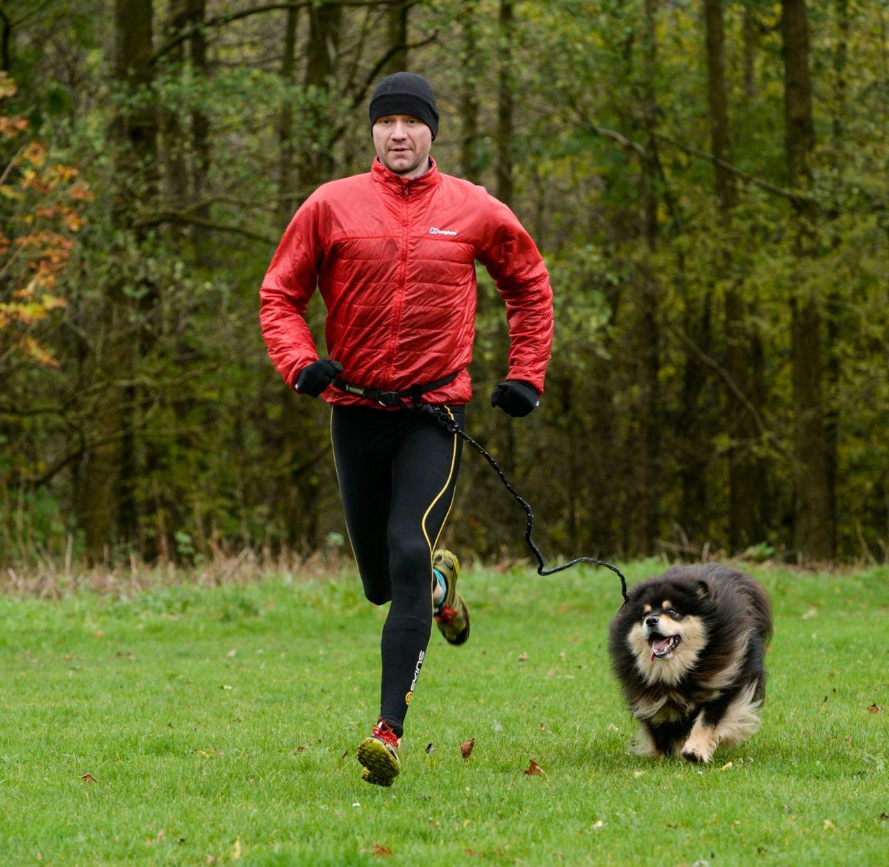 Triathlete running with his dog