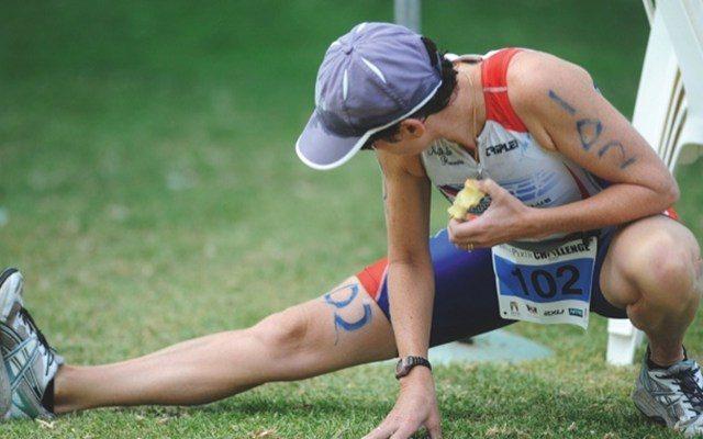 Triathlete stretching their legs