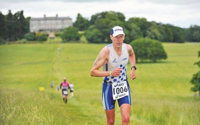 Martyn Brunt running up a hill
