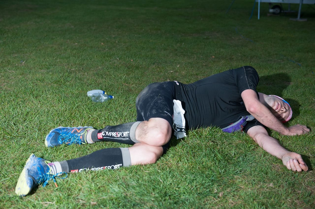 Triathlete on the ground after The Brutal