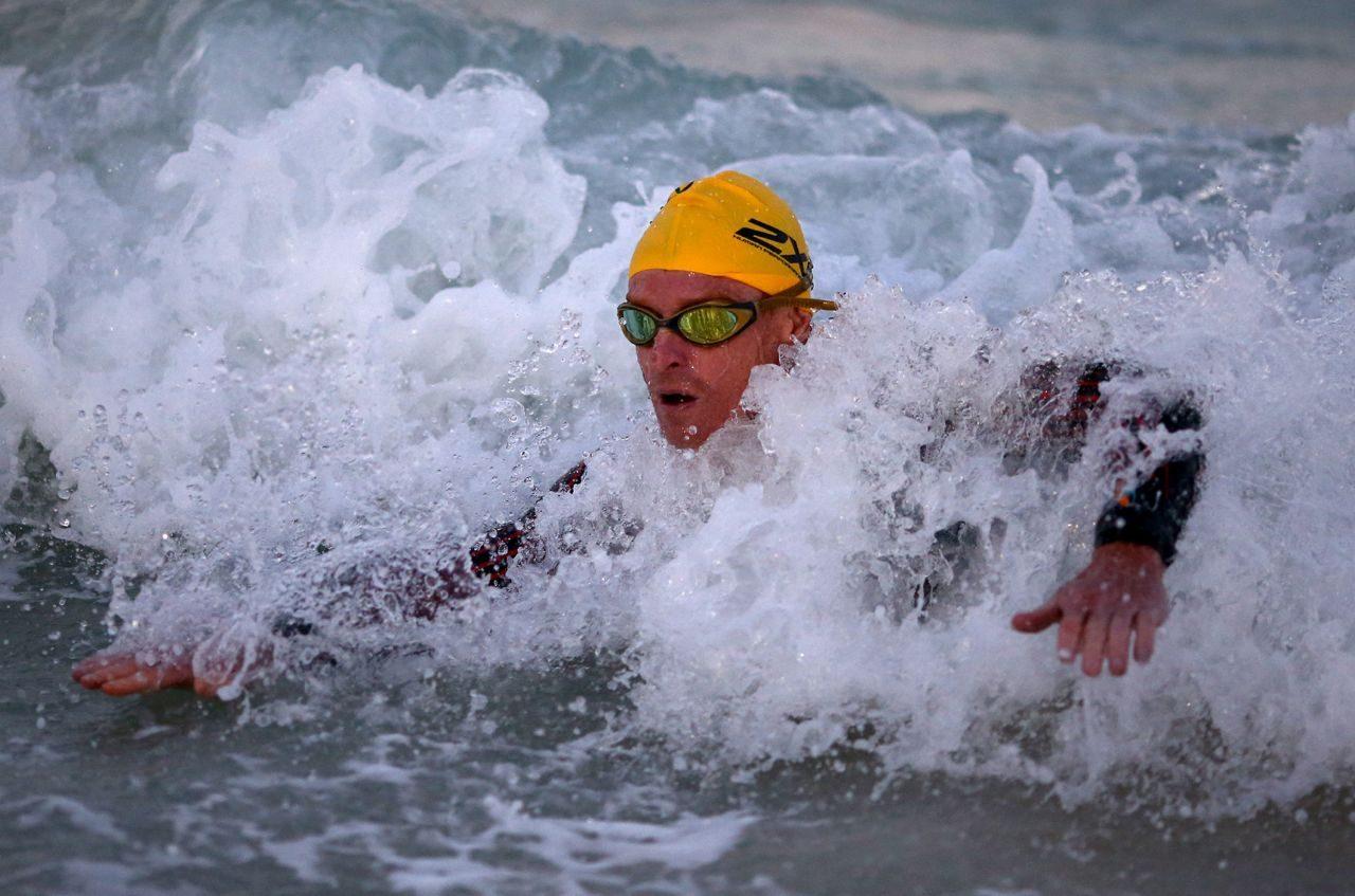 Triathlete swimming in the sea