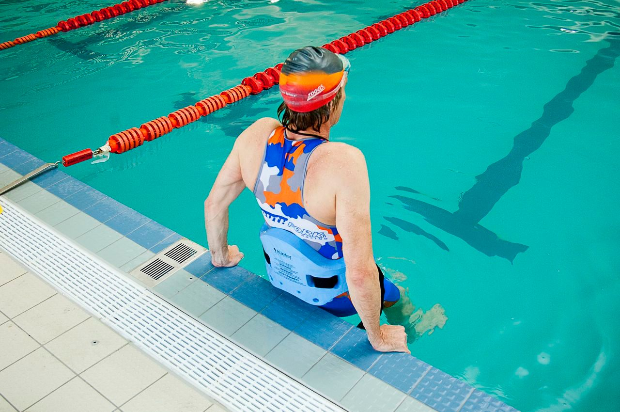 Swimmer entering the pool