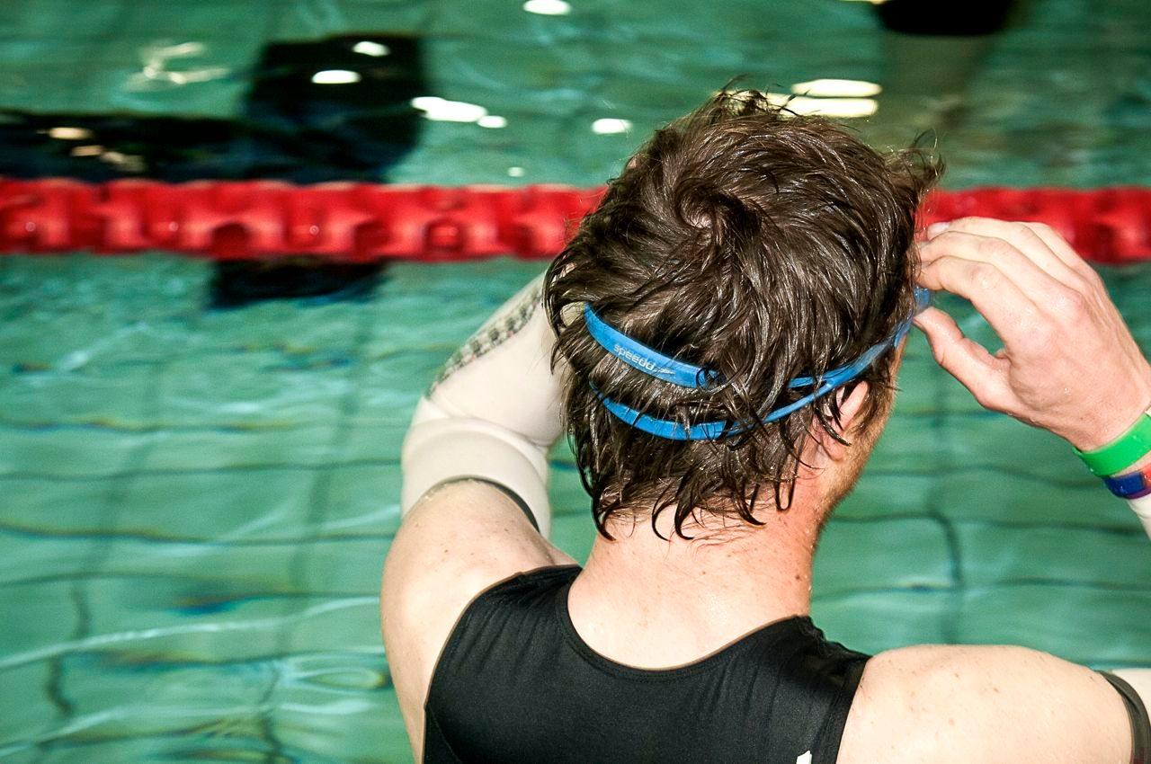 Triathlete preparing for a pool swim session