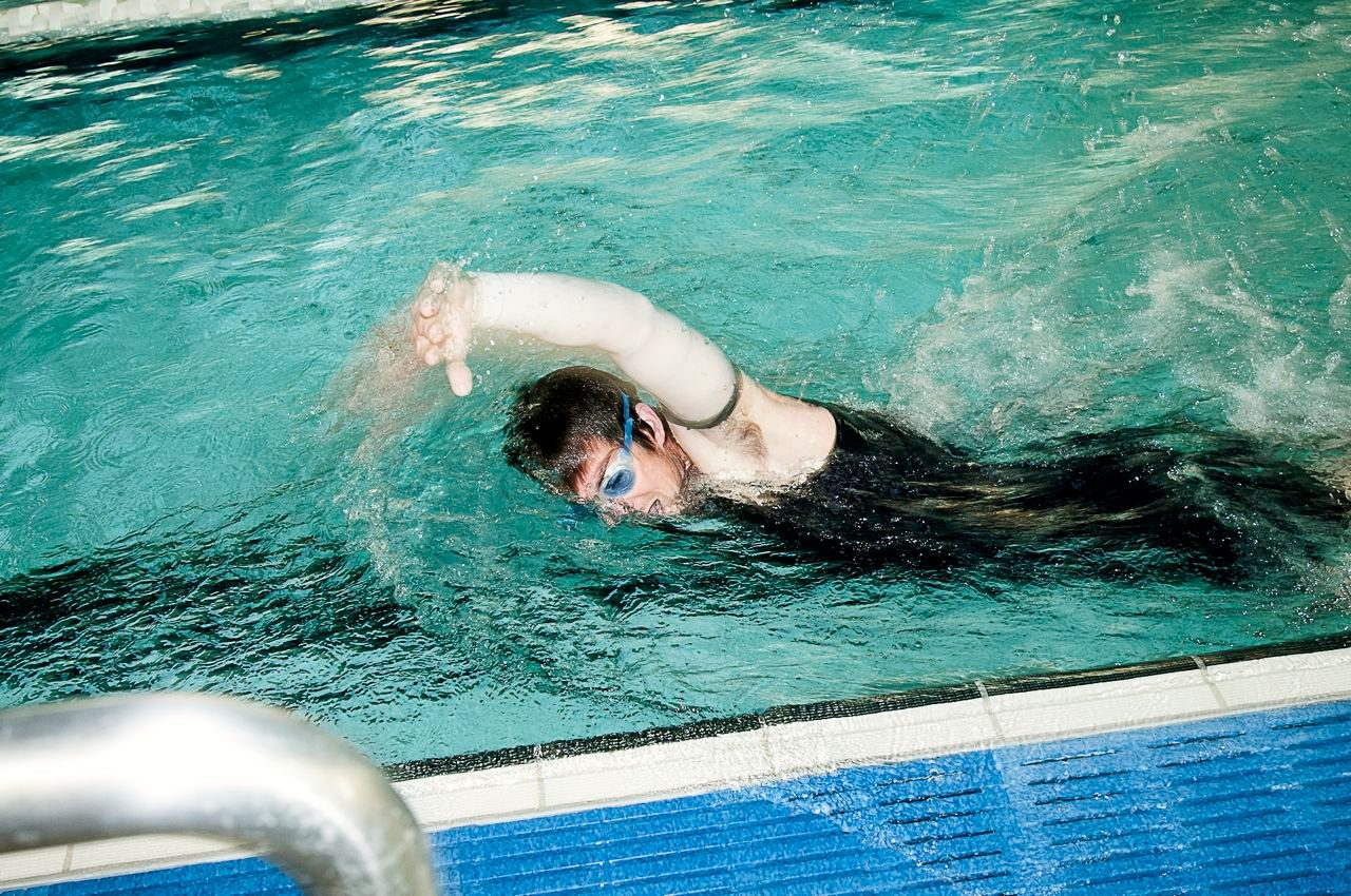 Triathlete in pool swim training