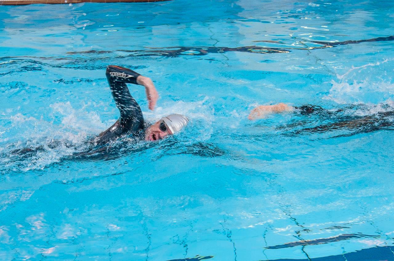 Two triathletes practising swim drafting