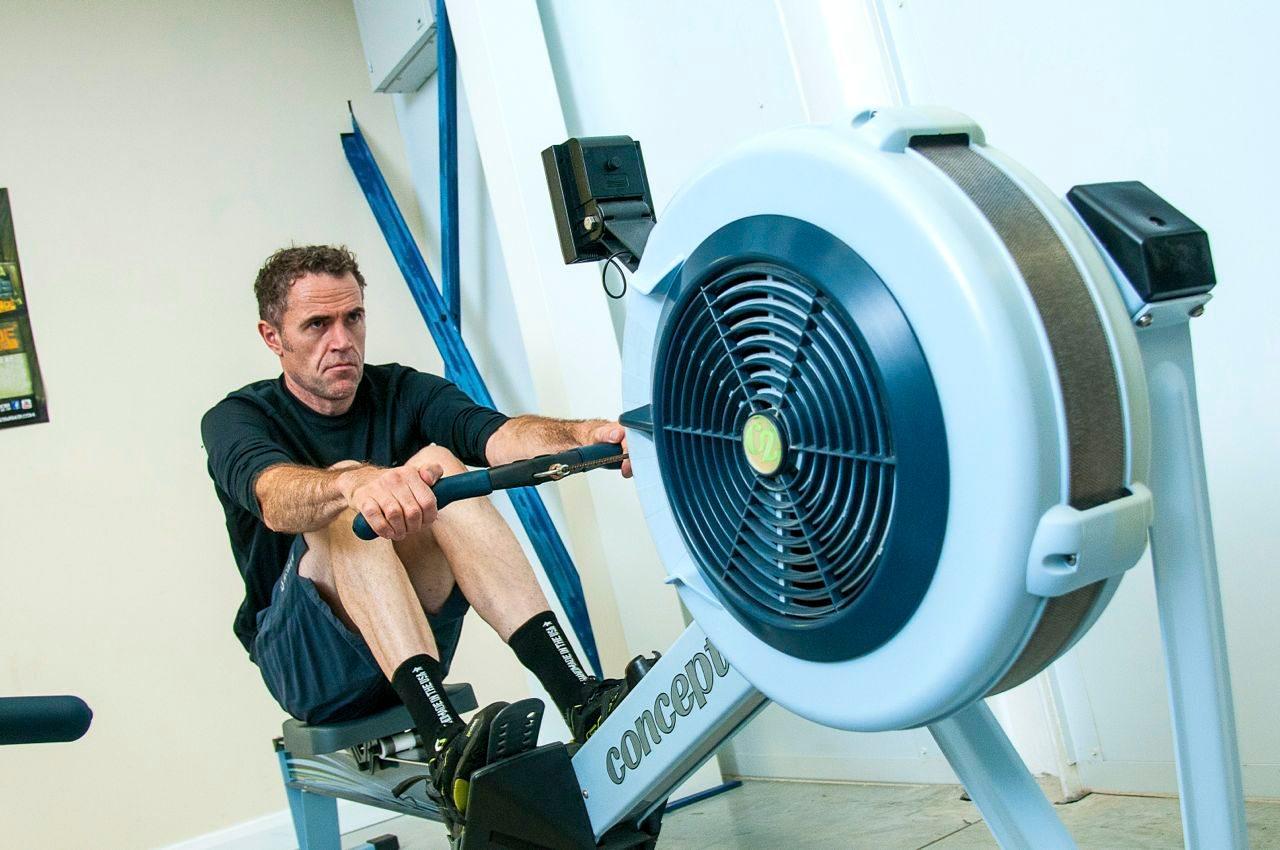 Joe Beer on a rowing machine