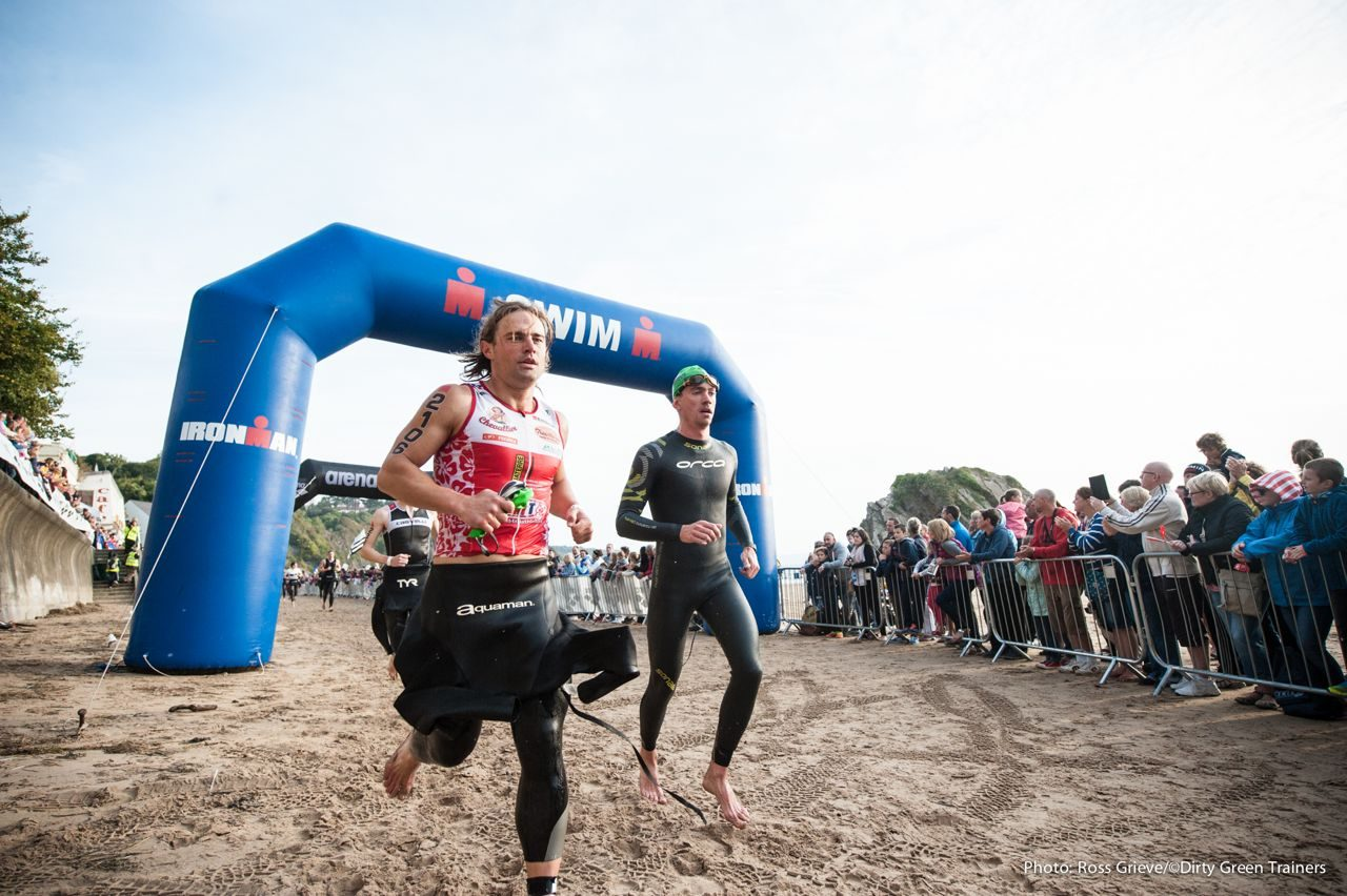 Athletes racing on the sand at Ironman Wales